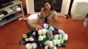 Elaine in a sea of donated yarn  – happy knitting!